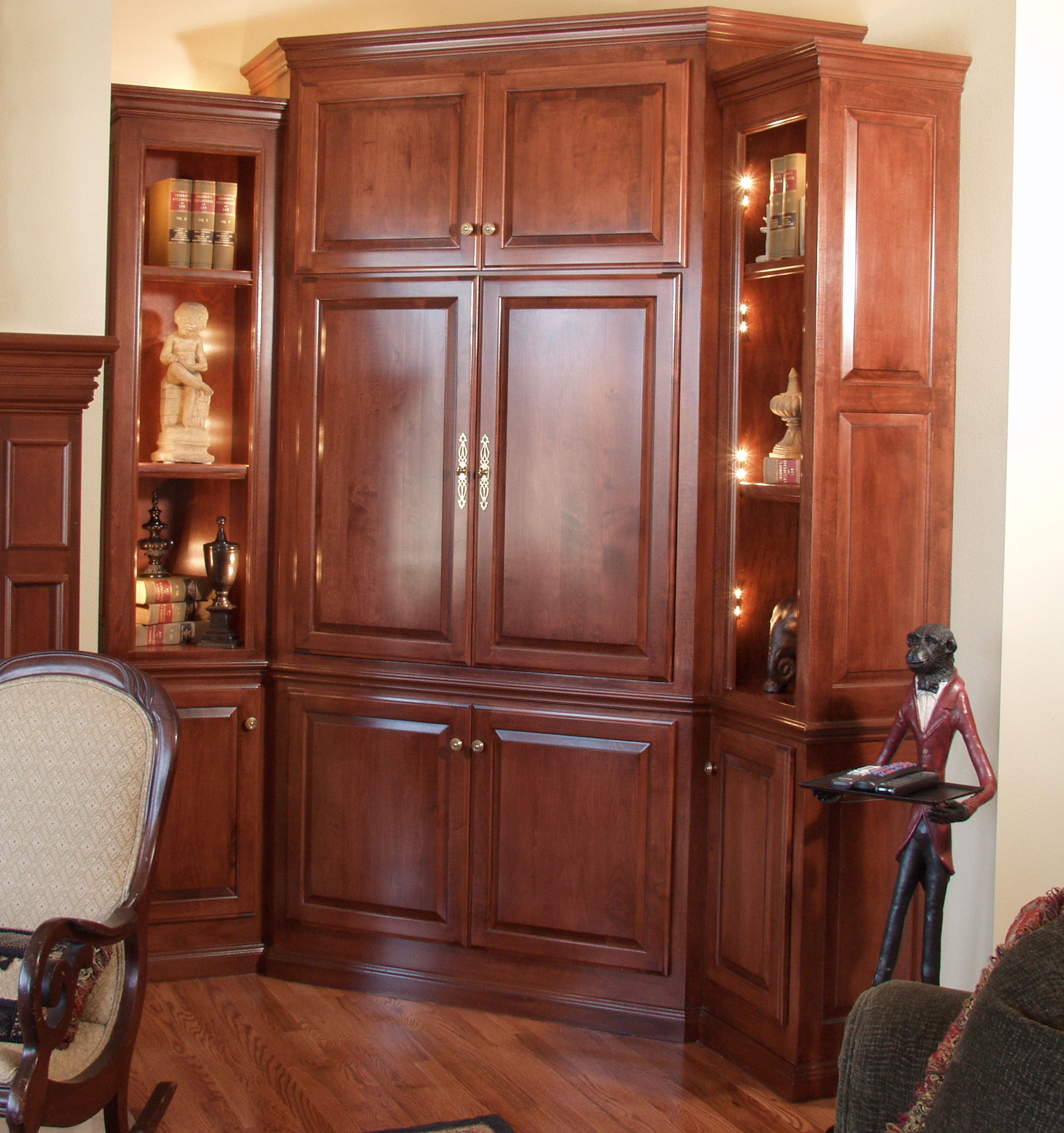 Corner media center cabinets shown with C101 - OE8, IE1, RP6 cabinet doors