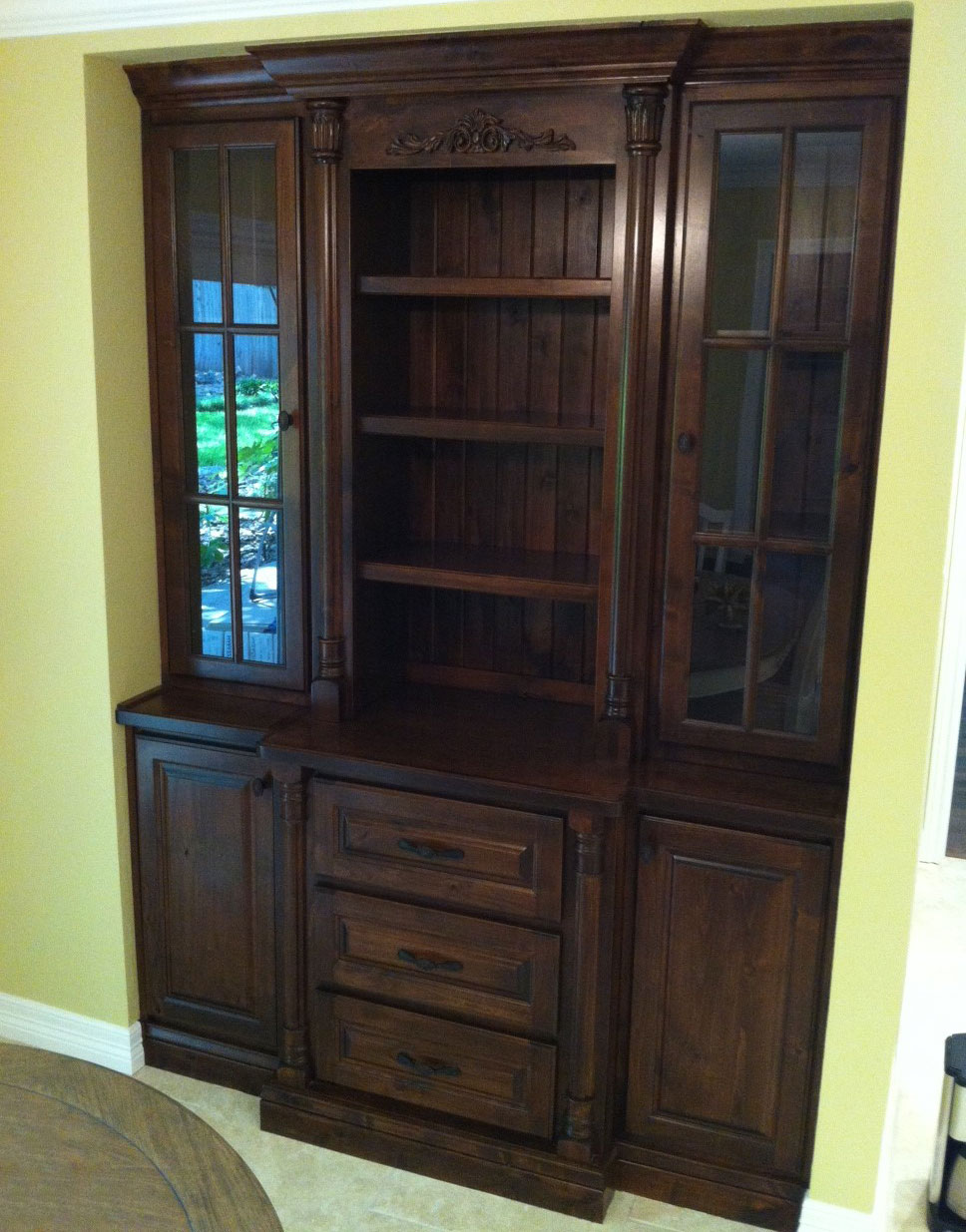Hutch in knotty alder with bead board back panel, cope and stick glass upper cabinet doors, solid-panel lower cabinet doors and drawer fronts