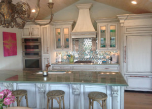 Coastal home kitchen cabinets shown with C101, OE8, IE3, FP1/4 and RP11 cope and stick cabinet doors in paint grade maple