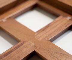 Walnut cabinet door dovetail key and half lap mullion construction