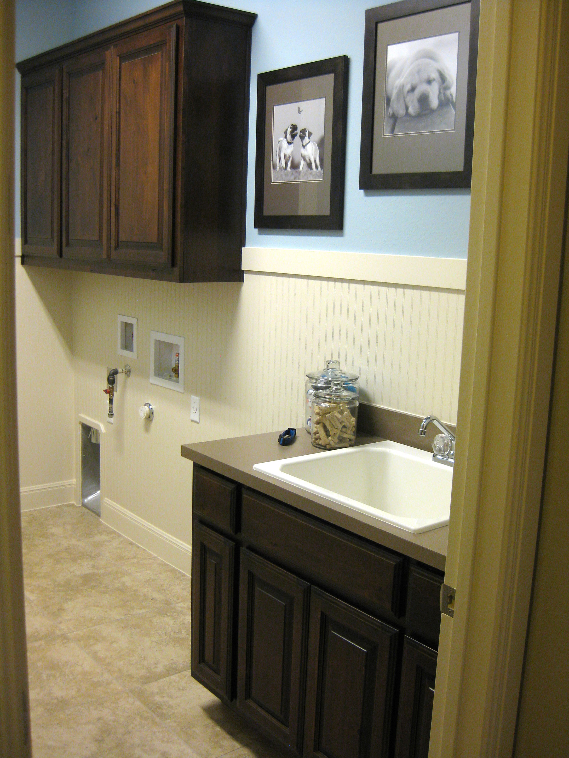 Laundry room cabinets with cope and stick cabinet doors by TaylorCraft Cabinet Door Company