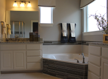 bathroom cabinets with cope and stick cabinet doors painted white with OE3, IE1, RP1 profiles