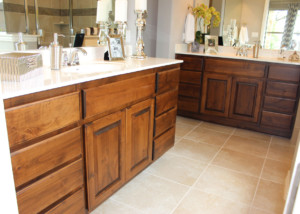 Master bath with knotty alder raised panel cabinet doors and slab drawer fronts by TaylorCraft Cabinet Door Company