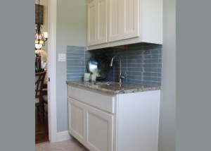 Laundry room cabinets with combination frame cabinet doors MW8 rails and FP1/4 panel in paint grade maple