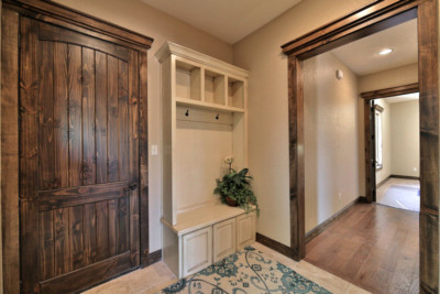 entry way bench seat cabinet with cubby holes and coat hangers