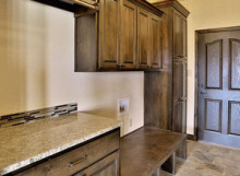 mud room cabinets with bench seat and coat closet in knotty alder