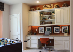 Game room workstation with raised panel cabinet doors by TaylorCraft Cabinet Door Company in paint grade hardwood