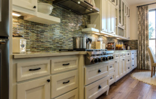 TaylorCraft Cabinet Door Company white kitchen cabinets with M101 mitered doors and flat panel