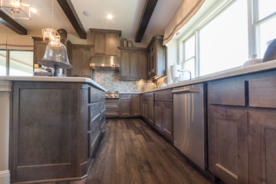 Kitchen with TaylorCraft's mitered cabinet doors MW6 flat panel in hard maple with gray stain