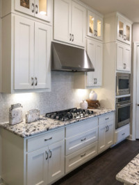 Large drawers under cooktop and wall oven with cabinet doors by TaylorCraft Cabinet Door Company