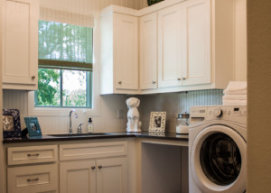 White laundry room cabinets with TaylorCraft Cabinet Door Company MW15 mitered frame and flat panel in paint grade material