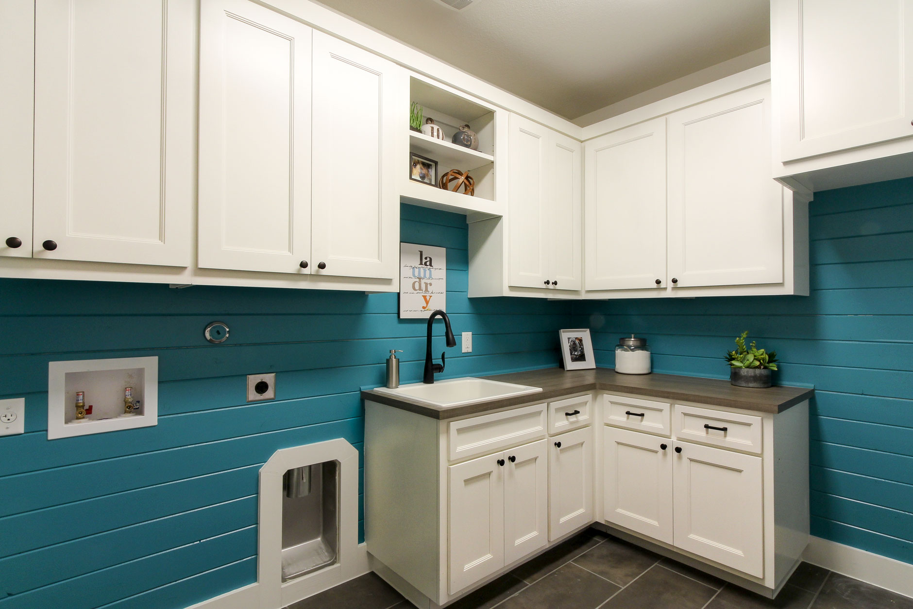 Laundry room white cabinets, turquoise shiplap walls, TaylorCraft Cabinet Doors with MW6 frame