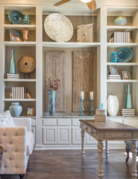 Study with built-in white bookshelves and paint-grade, raised panel cabinet doors by TaylorCraft