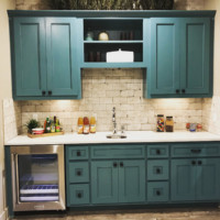 Green-blue wet bar cabinets with TaylorCraft's MW15 and FP1/4 mitered door profiles